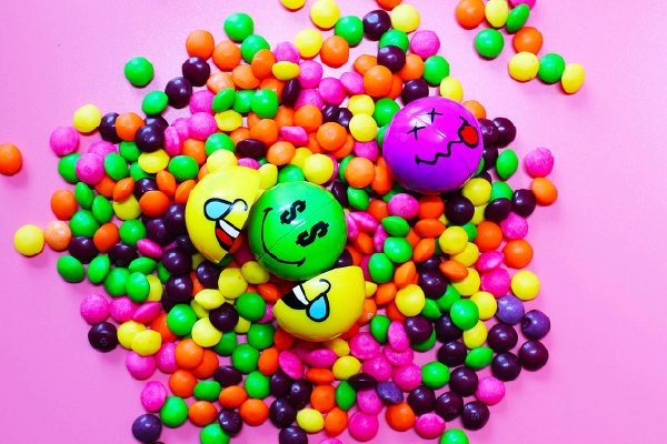 Smiley Halves on a pile of sweets