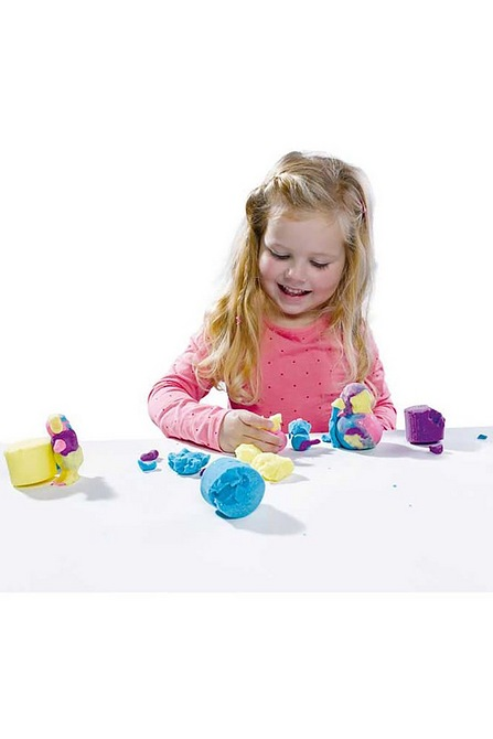 girl playing with glitter dough
